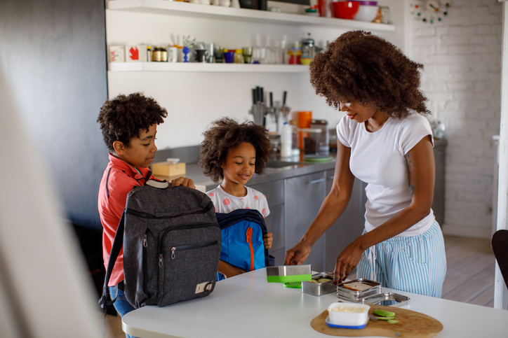 mother making back to school lunches for kids