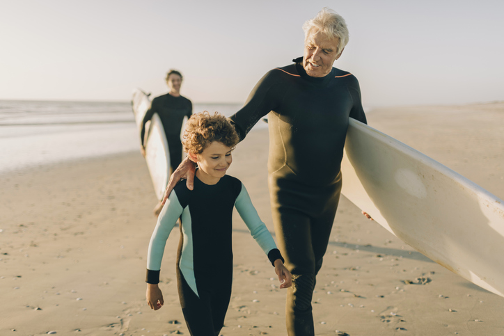 grandfather and grandson surfing staying active like the blue zones longest living generations