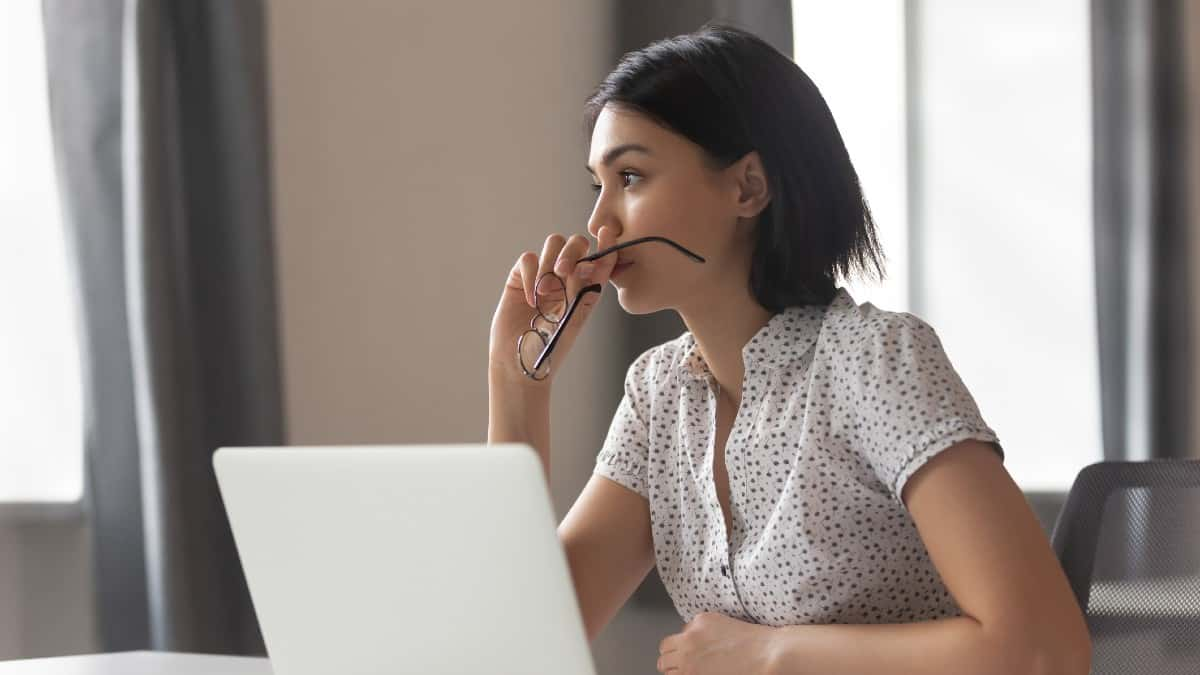 Thoughtful anxious asian business woman looking away thinking solving problem
