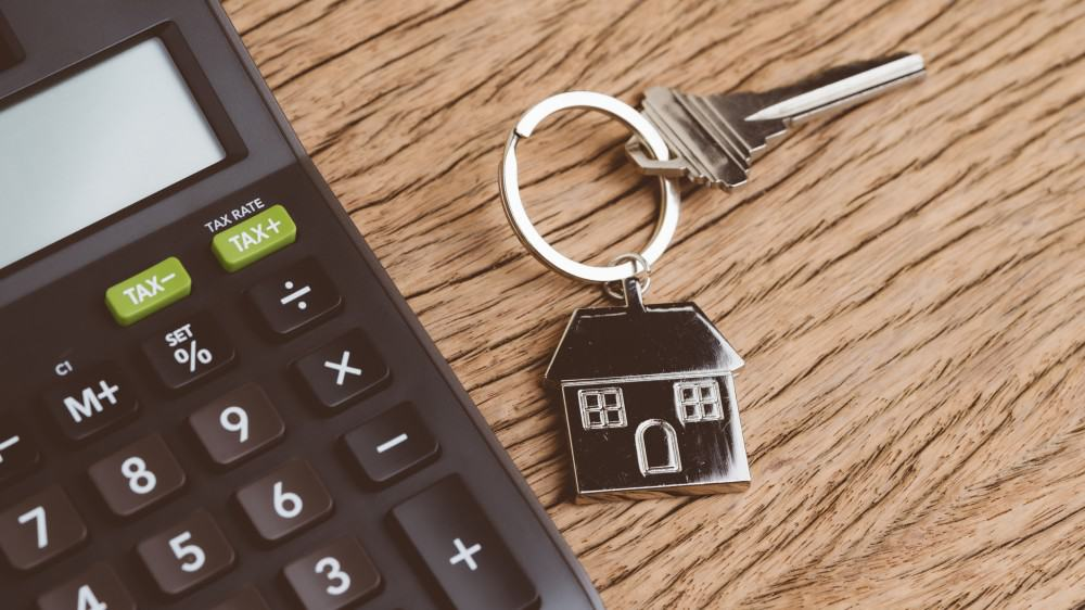 Home key with house keyring with calculator.