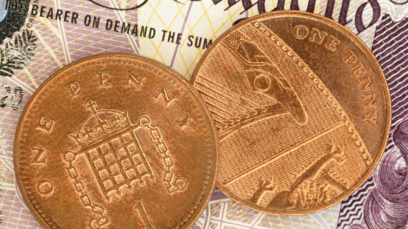 British Pennies on a Pound Note