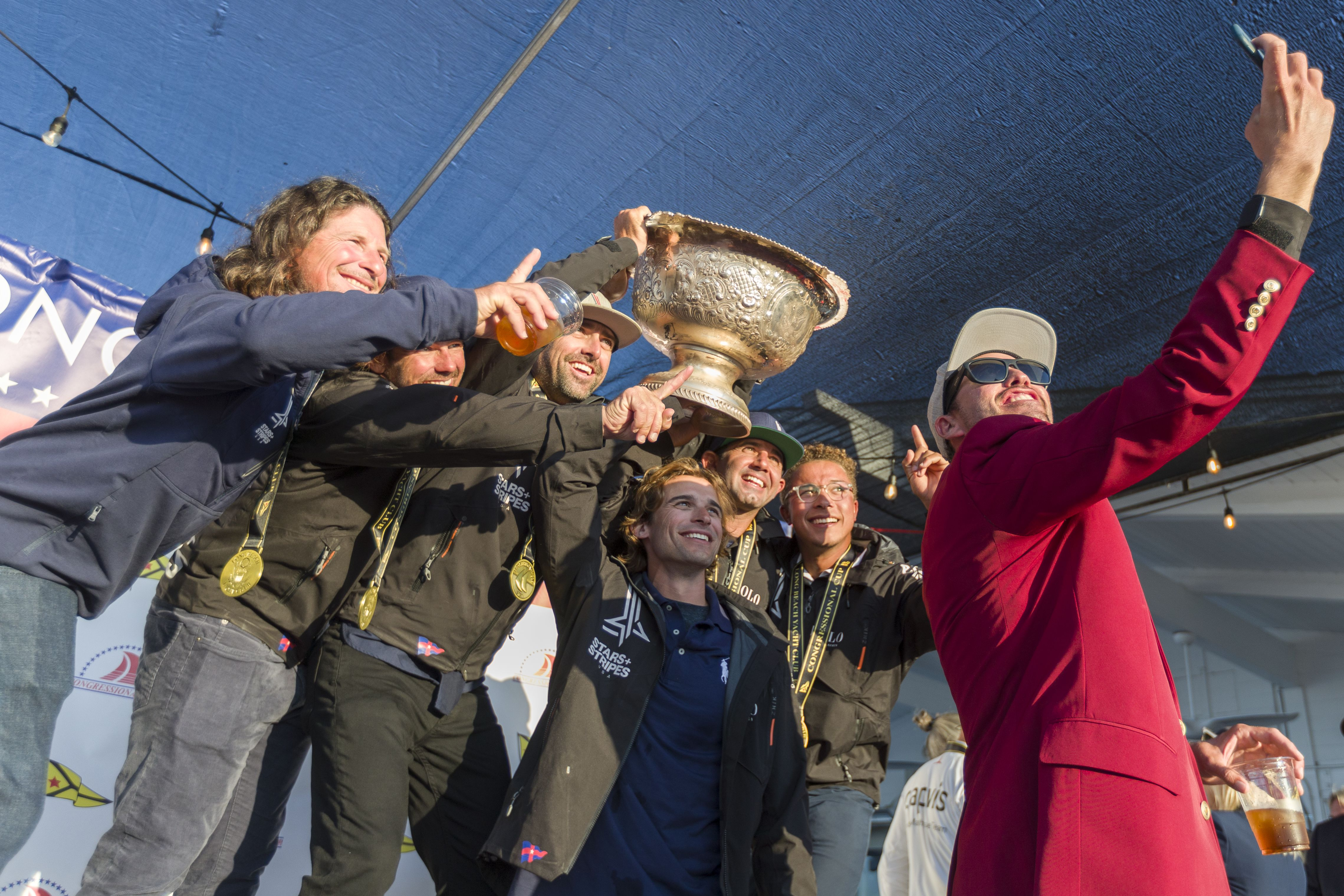 Stars + Stripes skipper Taylor Canfield and the Congressional Cup's winning squad celebrate a decisive victory in Long Beach.