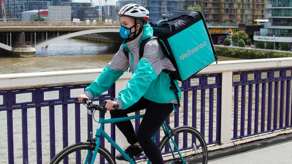 A Deliveroo rider cycles in London